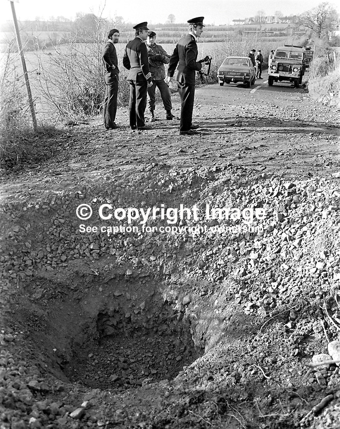 Police & army at the scene of a Provisional IRA 200lb boobytrap bomb explosion at Clare, near Cookstown, Co Tyrone, N Ireland, on 7th February 1976. Intended to lure police or army personnel to investigate what appeared to be a crashed car in a field the innocent victims were instead  a teenage brother and sister who lived nearby and as Good Samaritans had stopped to investigate. The brother and sister who died were Rachel McLernon, 21 years, and Robert McLernon, 16 years. 197602080084a..Copyright Image from Victor Patterson, 54 Dorchester Park, Belfast, UK, BT9 6RJ..Tel: +44 28 9066 1296.Mob: +44 7802 353836.Voicemail +44 20 8816 7153.Skype: victorpattersonbelfast.Email: victorpatterson@me.com.Email: victorpatterson@ireland.com (back-up)..IMPORTANT: If you wish to use this image or any other of my images please go to www.victorpatterson.com and click on the Terms & Conditions. Then contact me by email or phone with the reference number(s) of the image(s) concerned.
