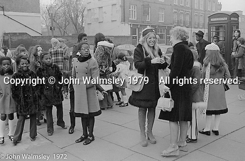 Anna Scher in head band.  Anna Scher Children's Theatre, East End of London 1972.  Kids would come after school and be expected to work hard.  Here, they're waiting for the coach to take them to the BBC for some filming.  Some went on to have careers in the industry and a few became household names: Pauline Quirk, Phil Daniels.