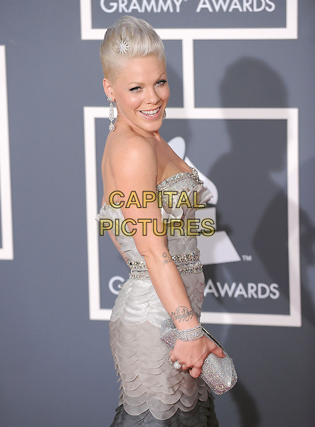 PINK (ALECIA MOORE).Arrivals at the 52nd Annual GRAMMY Awards held at The Staples Center in Los Angeles, California, USA..January 31st, 2010.grammys half length black grey gray strapless dress hand on hip piink pinnk beads beaded silver clutch bag dip dye dangling earrings .CAP/RKE/DVS.©DVS/RockinExposures/Capital Pictures