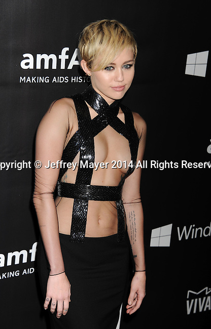 HOLLYWOOD, CA- OCTOBER 29: Recording artist Miley Cyrus  attends amfAR LA Inspiration Gala honoring Tom Ford at Milk Studios on October 29, 2014 in Hollywood, California.