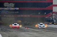 Jun. 18, 2011; Bristol, TN, USA: NHRA funny car driver Johnny Gray (left)alongside Tim Wilkerson during qualifying for the Thunder Valley Nationals at Bristol Dragway. Mandatory Credit: Mark J. Rebilas-