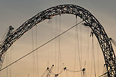 The steel arch of the partially completed roof of the new Wembley National Stadium in North London.