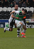 Ivan Sproule (right) and Dougie Imrie challenge in the St Mirren v Hibernian Clydesdale Bank Scottish Premier League match played at St Mirren Park, Paisley on 29.4.12.