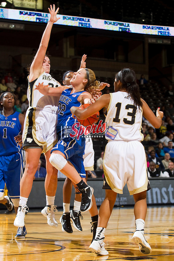 Tricia Liston #32 of the Duke Blue Devils loses the ball as she tries to drive past Lindsy Wright #31 and Mykala Walker #13 of the Wake Forest Demon Deacons at the LJVM Coliseum on January 6, 2012 in Winston-Salem, North Carolina.  The Blue Devils defeated the Demon Deacons 76-58.    (Brian Westerholt / Sports On Film)