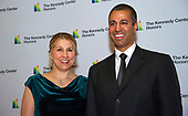 Chairman of the Federal Communications Commission (FCC) Ajit Pai, right, and his wife, Janine Van Lancker, left, arrive for the formal Artist's Dinner honoring the recipients of the 42nd Annual Kennedy Center Honors at the United States Department of State in Washington, D.C. on Saturday, December 7, 2019. The 2019 honorees are: Earth, Wind & Fire, Sally Field, Linda Ronstadt, Sesame Street, and Michael Tilson Thomas.<br /> Credit: Ron Sachs / Pool via CNP