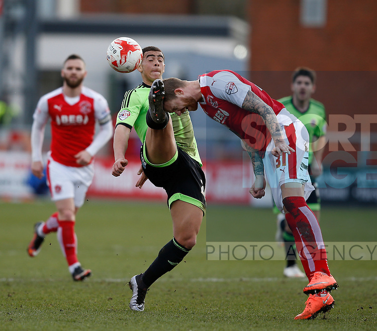 Marcus Nilsson of Fleetwood Town gets his head in a dangerous place as Che Adams of Sheffield Utd closes him down - English League One - Fleetwood Town vs Sheffield Utd - Highbury Stadium - Fleetwood - England - 5rd March 2016 - Picture Simon Bellis/Sportimage