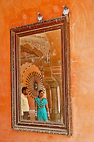 Indian man and woman reflected in mirror, Amber Fort, Jaipur, India