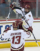 Cam Atkinson (BC - 13) and Carl Sneep (BC - 7) celebrate Sneep's game-tying goal. - The Boston College Eagles defeated the Merrimack College Warriors 4-3 on Friday, October 30, 2009, at Conte Forum in Chestnut Hill, Massachusetts.
