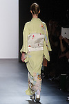 "Model walks runway in a ""Sprouting"" silk kimono from the Hiromi Asai Fall Winter 2016 ""Spirit of the Earth"" collection by Hiromi Asai & Kimono Artisan Kyoto, presented at NYFW: The Shows Fall 2016, during New York Fashion Week Fall 2016."