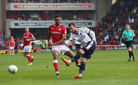 Bolton Wanderers' Adam Le Fondre is tackled by Barnsley's Jacob Hanson<br /> <br /> Photographer Rachel Holborn/CameraSport<br /> <br /> The EFL Sky Bet Championship - Barnsley v Bolton Wanderers - Saturday 14th April 2018 - Oakwell - Barnsley<br /> <br /> World Copyright &copy; 2018 CameraSport. All rights reserved. 43 Linden Ave. Countesthorpe. Leicester. England. LE8 5PG - Tel: +44 (0) 116 277 4147 - admin@camerasport.com - www.camerasport.com
