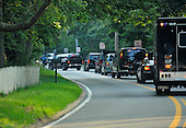 President Barack Obama motorcade turns into Blue Heron Farm in Chilmark, Massachusetts  after arriving for his vacation at Martha's Vineyard Airport in West Tisbury, Massachusetts on August 18, 2011 ..Credit: Rick Friedman / Pool via CNP