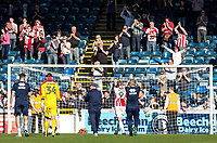 The Cheltenham Town players and manager Gary Johnson are applauded by the travelling fans after they earned a valuable point playing with 10 men for the majority of the match during the Sky Bet League 2 match between Wycombe Wanderers and Cheltenham Town at Adams Park, High Wycombe, England on the 8th April 2017. Photo by Liam McAvoy.