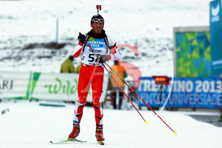 Ahmet Ustuntas (TUR)  competes during the 20 km Individual Biathlon race as part of the Winter Universiade Trentino 2013 on 15/12/2013 in Lago Di Tesero, Italy.<br /> <br /> &copy; Pierre Teyssot - www.pierreteyssot.com