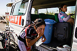 SULAIMANIYAH, IRAQ: Cyclist Nyan Yassin refreshes herself after competing in individual team time trials in temperatures of over 30&ordm;C.<br /> <br /> Nyan Yassin, 24, is a professional competitive cyclist in Sulaimaniyah in the semi-autonomous region of Iraqi Kurdistan.  She is the captain of an all-female club called Newroz Club, which is the only cycling club for women in Sulaimaniyah, although there are other clubs around Iraq.  She trains and competes on roads that are badly surfaced and busy with traffic.<br /> <br /> Nyan was the first woman to start cycling in Sulaimaniyah.  She was always competitive and after trying her hand at different sports she settled on cycling.  She is now the top female cyclist in Iraq.  Her nickname is MigMig after the noise made by the cartoon character Roadrunner.<br /> <br /> Despite being clearly talented at her sport Nyan knows that in a couple of years she will have to get married and then abandon it as, in the traditional society that Kurdistan is, being a wife and a competitive sportswoman at the same time is not an option.<br /> <br /> Photo by Gona Hassan/Metrography