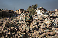 IRAK, Karqasha; A Peshmerga fighter is walking in the ruins of Karkasha town liberated from Daesh by the Peshmergas 2 months ago, the 6th December 2016. <br /> <br /> IRAK, Karqasha; Un combattant Peshmerga marche dans les ruines de la ville de Karkasha lib&eacute;r&eacute;e de Daesh par le Peshmergas il y a 2 mois, le 6 d&eacute;cembre 2016.