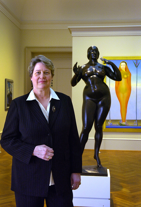 "The Field-McCormick Curator of American Art,  Judith Barter, in front of the sculpture ""Standing Woman"", by Gaston LaChaise (1912) and the painting ""A Vision"", by Joseph Stella (c1926)."