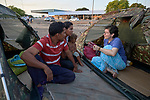 Consolata Sister Inés Arciniegas visits with Venezuelan refugees who sleep in tents outside the main bus terminal in Boa Vista, Brazil.  Arciniegas is from Colombia.