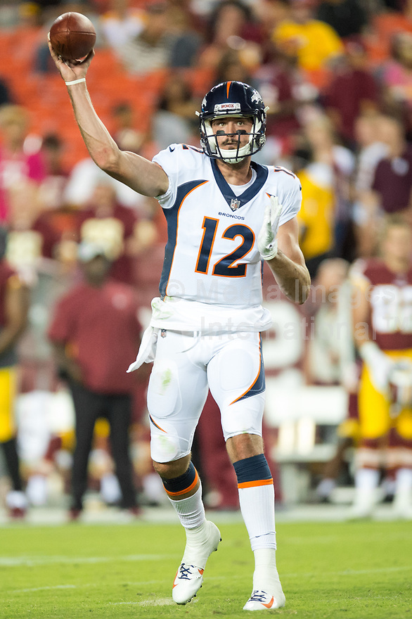 Landover, MD - August 24, 2018: Denver Broncos quarterback Paxton Lynch (12) drops back to throw the ball during preseason game between the Denver Broncos and Washington Redskins at FedEx Field in Landover, MD. The Broncos defeat the Redskins 29-17. (Photo by Phillip Peters/Media Images International)