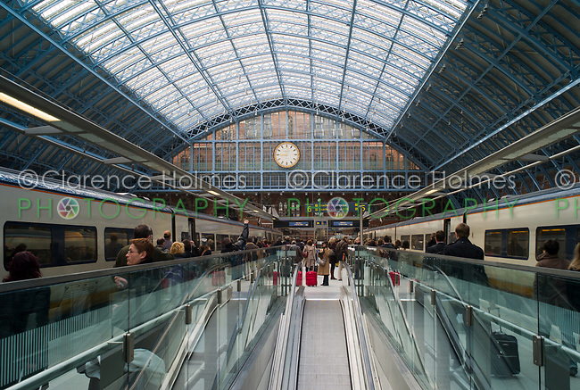 Passengers arrive and board high-speed Eurostar trains in St. Pancras station in London, England, UK.