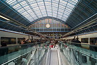 Passengers arriving and boarding high-speed Eurostar trains in St. Pancras station, London, England