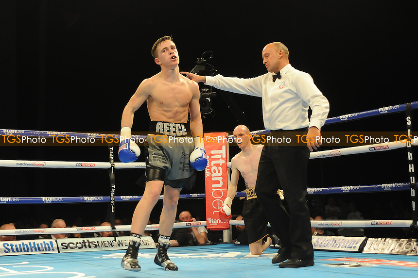 Reece Mould stops Phil Harvey (Black and gold shorts) in the first round on his professional debut during a Boxing show at the First Direct Arena on 16th April 2016