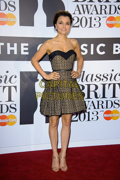Samantha Barks<br /> Classical Brit Awards 2013 at The Royal Albert Hall - Arrivals, London, England.<br /> 2nd October, 2013<br /> full length black strapless dress yellow lace cleavage dress hands on hips belt <br /> CAP/CJ<br /> &copy;Chris Joseph/Capital Pictures