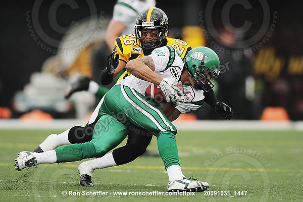 October 31, 2009; Hamilton, ON, CAN;  Hamilton Tiger-Cats defensive back Chris Thompson (26) tackles Saskatchewan Roughriders wide receiver Chris Jones (3). CFL football: Saskatchewan Roughriders vs. Hamilton Tiger-Cats at Ivor Wynne Stadium. The Tiger-Cats defeated the Roughriders 24-6. Mandatory Credit: Ron Scheffler. Copyright (c) 2009 Ron Scheffler.