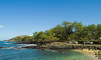 The remote rocky shoreline and windswept vegetation of Beau Chien beach at La Perouse Bay on the Makena coast of West Maui.