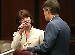 Nevada Assembly Republicans Robin Titus and Chris Edwards talk on the Assembly floor at the Legislative Building in Carson City, Nev., on Thursday, May 7, 2015.<br /> Photo by Cathleen Allison