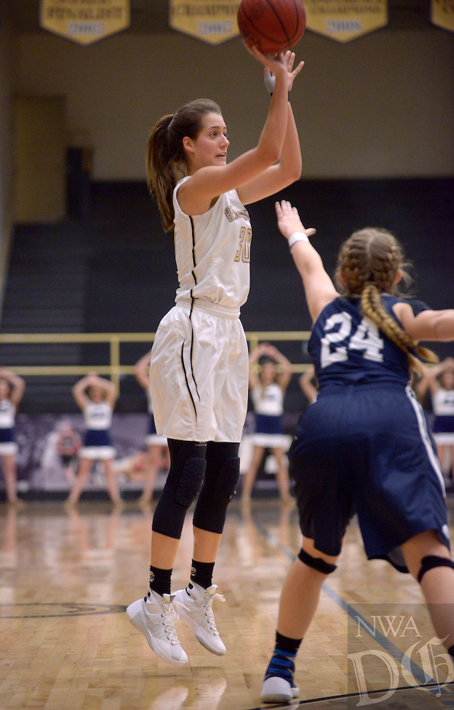 NWA Democrat-Gazette/BEN GOFF @NWABENGOFF<br /> Madison Brittain of Bentonville makes a shot for three as Ashley Rozell of Greenwood guards on Thursday Dec. 17, 2015 during the game in Bentonville's Tiger Arena.