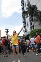 SÃO BERNARDO DO CAMPO,SP, 05.03.2016 - PROTESTO-SP - A modelo Ju Isen, conhecida como a musa das manifestações contra o atual governo de Dilma Rousseff e contra o PT, foi até a frente da casa do ex-Presidente, Luiz Inácio Lula da Silva, em São Bernardo do Campo, Grande São Paulo, e precisou sair escoltada pela Polícia Militar, na manhã deste sábado, 5. (Foto: Marcelo Brammer/Brazil Photo Press)