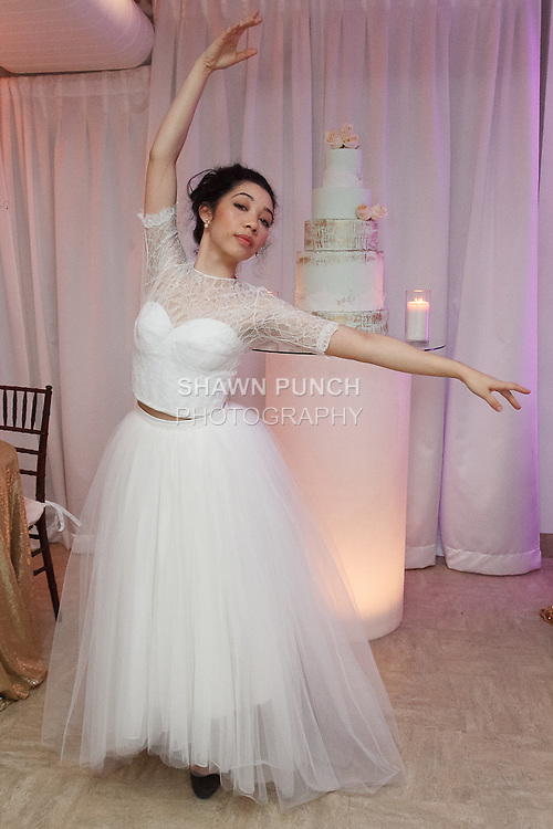 Model dances in a wedding dress from the Pas de Deux Bridal collection at the With This Ring event, host by Menagerie and Punto Space, at 325 West 38th street in New York City, during New York Bridal Fashion Week Spring Summer 2017.