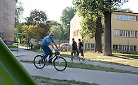 Bicycling a common means of Polish transportation for young and old. Balucki District Lodz Central Poland