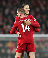 1st February 2020; Anfield, Liverpool, Merseyside, England; English Premier League Football, Liverpool versus Southampton; Jordan Henderson of Liverpool hugs team mate Virgil van Dijk as he is substituted off late in the match