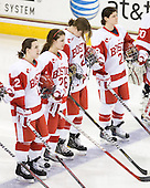 Jill Cardella (BU - 22), Anya Battaglino (BU - 26), Tara Watchorn (BU - 27), Louise Warren (BU - 28) - The Northeastern University Huskies tied Boston University Terriers 3-3 in the 2011 Beanpot consolation game on Tuesday, February 15, 2011, at Conte Forum in Chestnut Hill, Massachusetts.