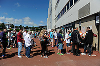 Fans queue to enter the Liberty Stadium for today's friendly match. Saturday 06 August 2016<br /> Re: Pre season friendly, Swansea v Stade Rennais at the Liberty Stadium, Swansea, UK