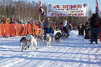 Conway Seavey leaves the start line of the Junior Iditarod  at Knik Lake, Knik, Alaska
