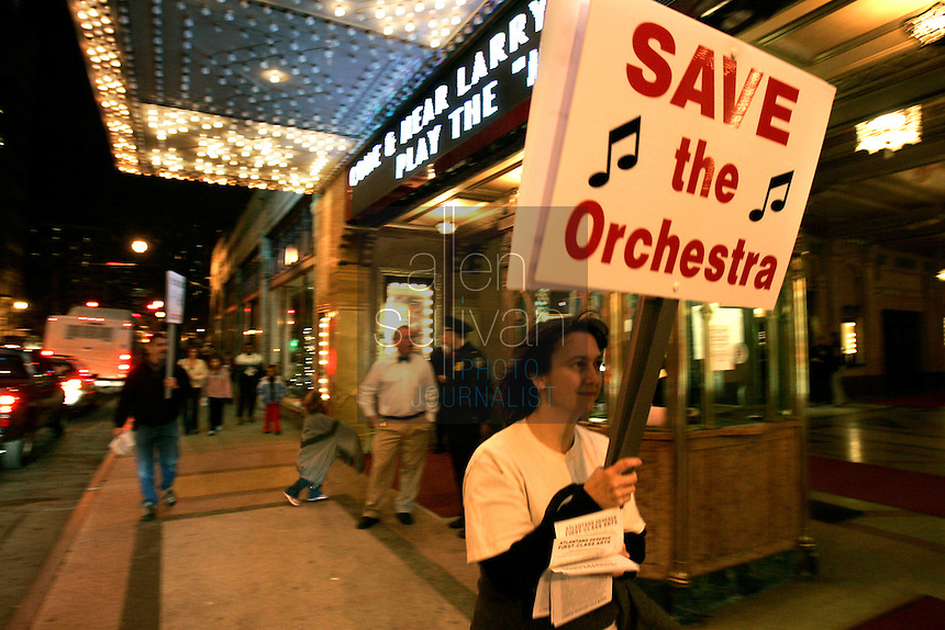 French horn player Julie Spencer pickets the Fox Theatre with other members of the Atlanta Ballet Orchestra during a performance of &quot;The Nutcracker.&quot; Last summer the Atlanta Ballet announced it would begin using recorded music for all of its productions and fired the orchestra. The American Federation of Musicians Local 148-462 has filed an unfair labor practice complaint. (Contact info: Mary Kenney of the orchestra (404) 888-0787)<br />