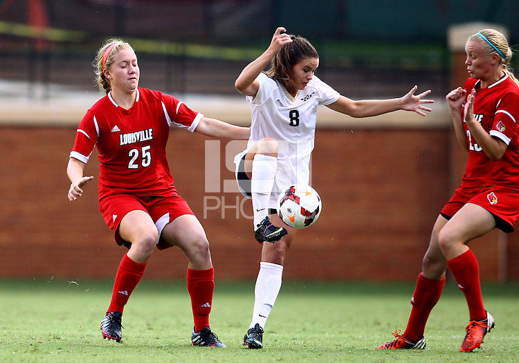 WINSTON-SALEM, NORTH CAROLINA - September 01, 2013:<br />  Caroline Kimble (25)) and Casey Whitfield (23) of Louisville University surround Ally Berry (8) of Wake Forest University during a match at the Wake Forest Invitational tournament at Wake Forest University on September 01. The match was abandoned early in the second half due to severe weather with Wake leading 1-0.