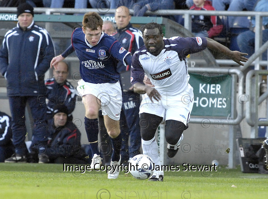 24/11/2007      Copyright Pic: James Stewart.File Name : sct_jspa21_falkirk_v_rangers.JEAN-CLAUDE DARCHEVILLE GETS AWAY FROM FALKIRK'S PATRICK CREGG....James Stewart Photo Agency 19 Carronlea Drive, Falkirk. FK2 8DN      Vat Reg No. 607 6932 25.Office     : +44 (0)1324 570906     .Mobile   : +44 (0)7721 416997.Fax         : +44 (0)1324 570906.E-mail  :  jim@jspa.co.uk.If you require further information then contact Jim Stewart on any of the numbers above.........