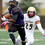 SIOUX FALLS, SD - OCTOBER 18: Solomon St. Pierre #19 from the University of Sioux Falls steps in front of intended receiver Nathaniel Huot #25 from Southwest Minnesota State, for his first of three interceptions on the day, in the first half of their game Saturday afternoon at Bob Young Field in Sioux Falls. (Photo by Dave Eggen/Inertia)