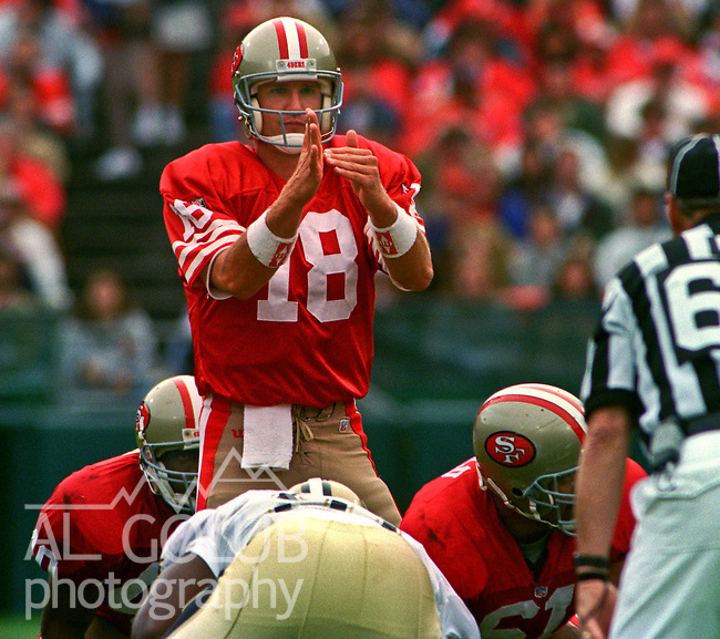 San Francisco 49ers vs. New Orleans Saints at Candlestick Park Sunday, October 29, 1995.  Saints beat 49ers  11-7.  San Francisco 49ers quarterback Elvis Grbac (18) call time out.