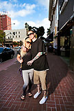 USA, California, San Diego, tattoo artist Zach and girlfriend Kseniva standing in front of Master Tattoo in the Gaslamp district, the oldest tattoo shop on the west coast