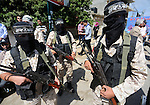 Masked Palestinian take part in a rally marking the 51th anniversary of the Popular Front for the Liberation of Palestine (General Command),in front of Red cross office, in Gaza city, on May 23, 2016. Photo by Mohammed Asad