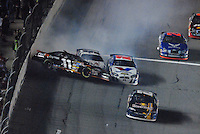 Feb 10, 2007; Daytona, FL, USA; Nascar Nextel Cup driver Denny Hamlin (11) is hit by Kasey Kahne (9) as he slides along the wall after crashing on the last lap during the Budweiser Shootout at Daytona International Speedway. Mandatory Credit: Mark J. Rebilas
