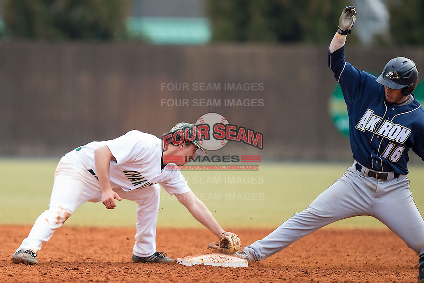 TJ Nichting (1) of the Charlotte 49ers tags out Brian Lees (16) of the Akron Zips as he slides into second base at Hayes Stadium on February 22, 2015 in Charlotte, North Carolina.  The Zips defeated the 49ers 5-4.  (Brian Westerholt/Four Seam Images)
