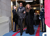 Recording artists Jay-Z and Beyonce arrive at the presidential inauguration on the West Front of the U.S. Capitol January 21, 2013 in Washington, DC.   Barack Obama was re-elected for a second term as President of the United States.     .Credit: Win McNamee / Pool via CNP