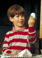 Boy coloring Easter egg. Family. Douglaston NY.