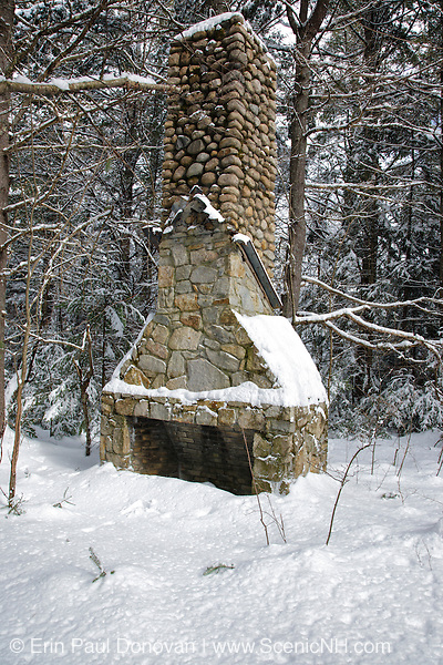 Old stone fireplace in the area of the abandoned Passaconaway Settlement in Albany, New Hampshire USA. This area was part of the Swift River Railroad era, which was an logging railroad in operation from 1906 - 1916