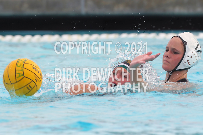 Manhattan Beach, CA 02/16/11 - Alys Williams (Edison #12) and Natalie Lavinsky (Mira Costa #3) in action during the 2011 first round CIF girls waterpolo playoffs between Edison and Mira Costa.